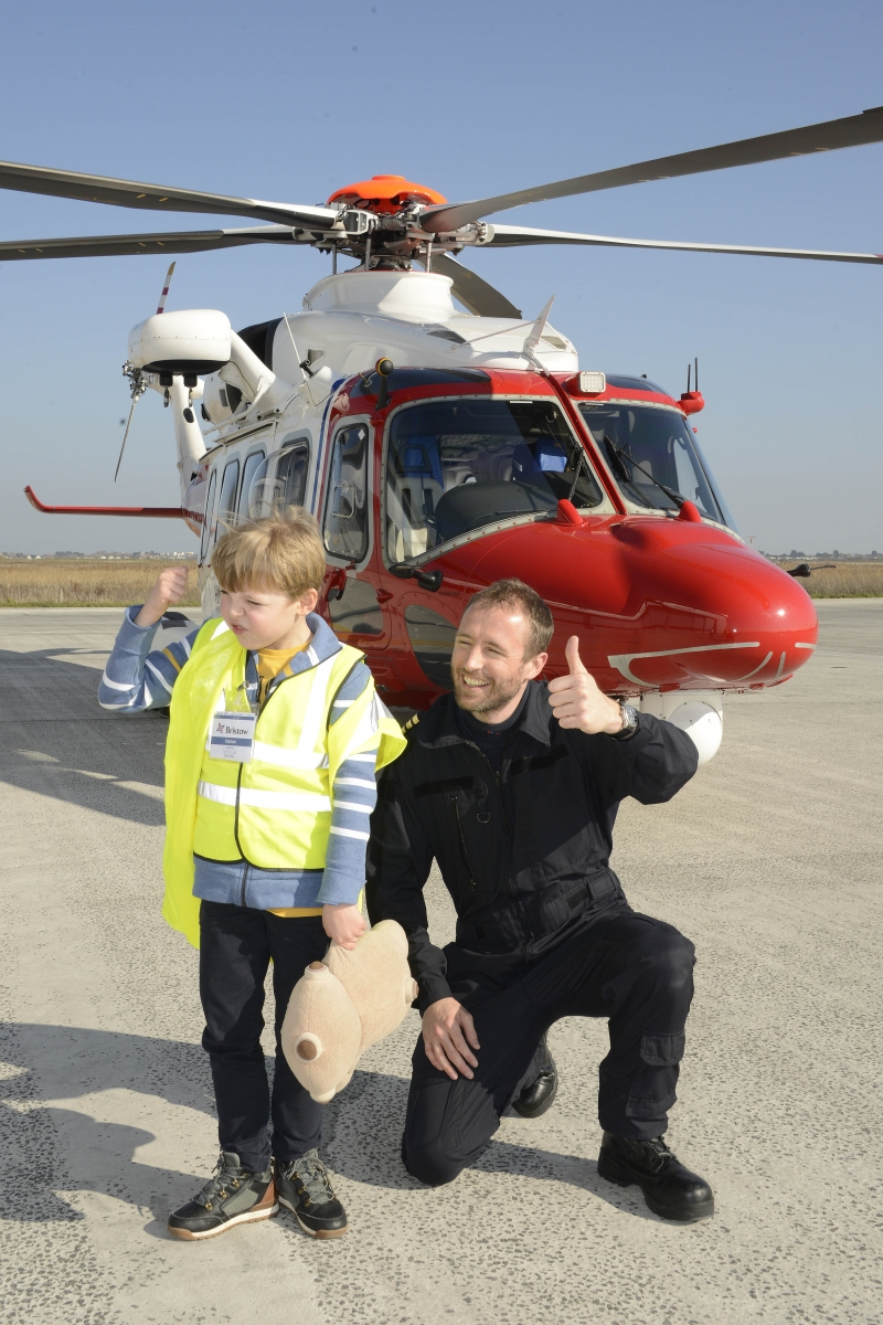 Daniel in front of a helicopter.