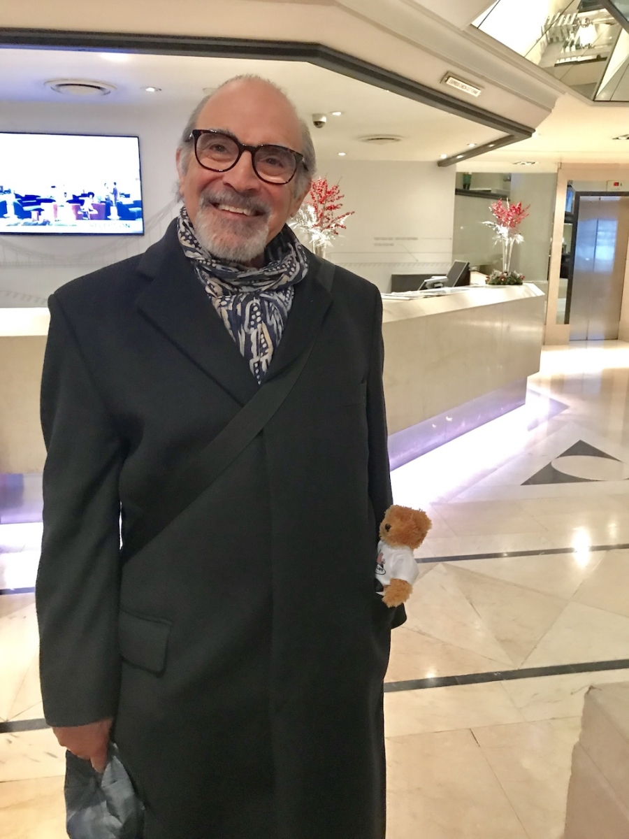 David Suchet looking very pleased with his bear!