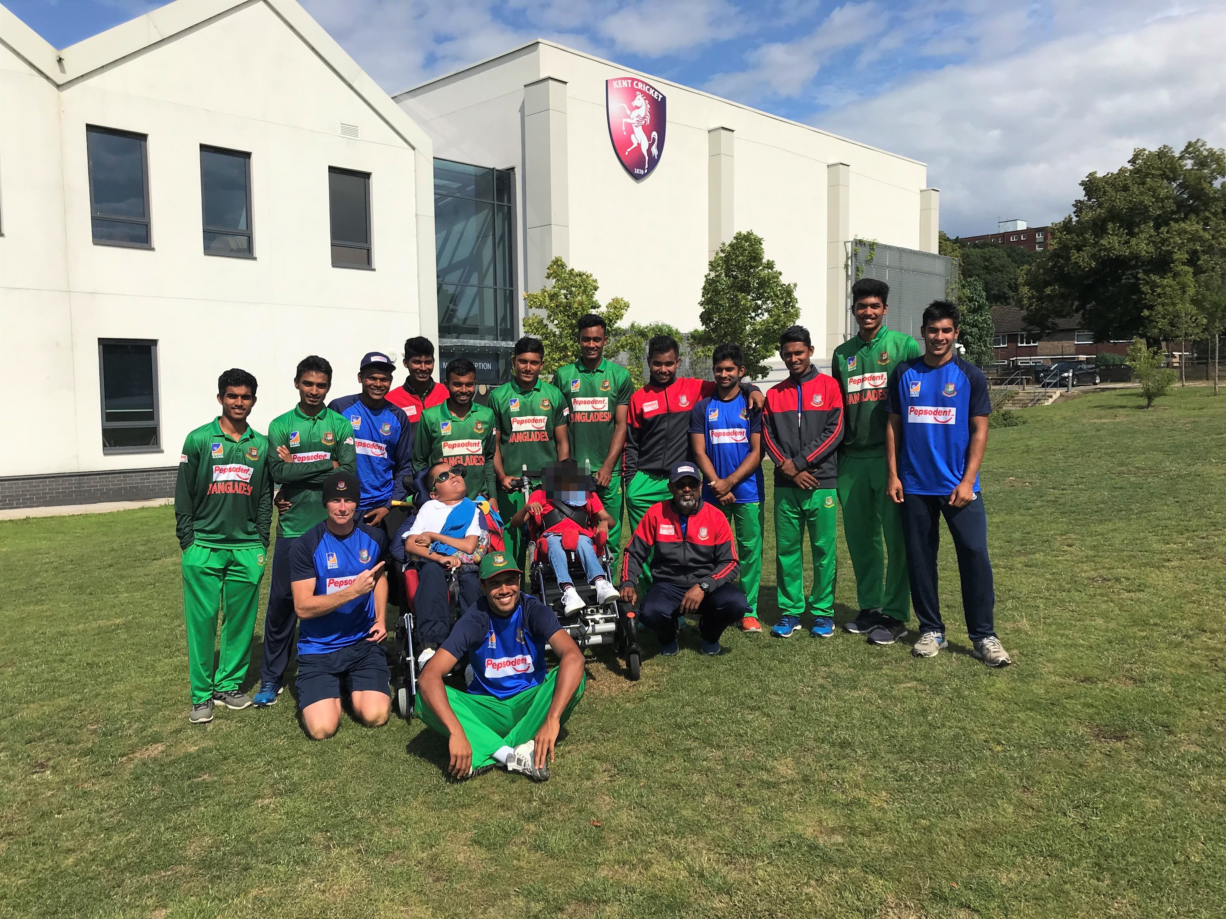The Bangladesh U19 cricket team with cricket fan Ibrahim