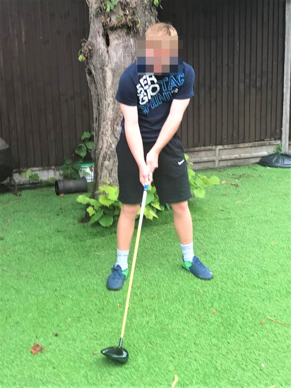 JW takes his state-of-the-art Callaway Rogue Driver for a few swings in his back garden