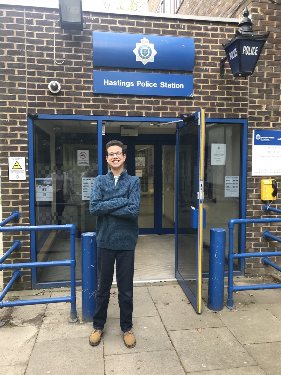 Martin poses in front of Hastings Police Station