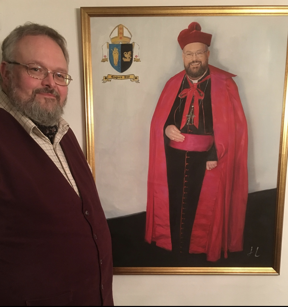 Damien with a portrait of him being consecrated 10 years ago.