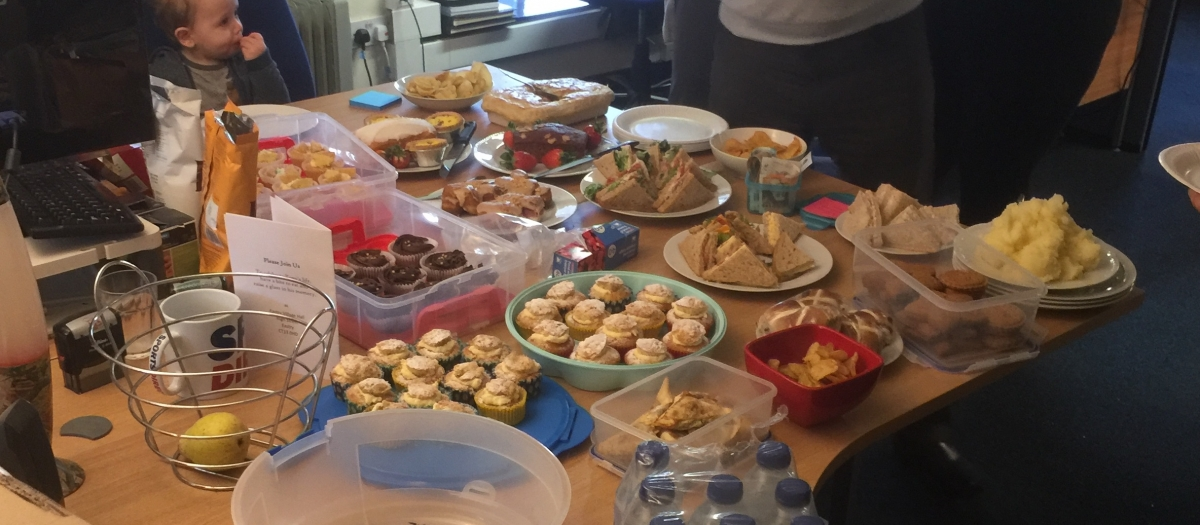 Many cakes and baked goods at the office.